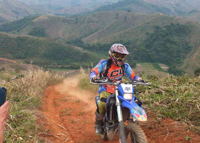 riding dirtbike on off road